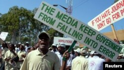FILE - Journalists chant anti-government slogans and sing songs as they celebrate World Press Freedom Day.