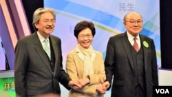 Hong Kong Chief Executive candidates, from left, John Tsang, Carrie Lam and Woo Kwok Hing attend TV Debate.