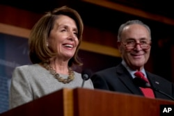 House Speaker Nancy Pelosi of Calif., and Senate Minority Leader Sen. Chuck Schumer of N.Y., smile during a news conference on Capitol Hill in Washington, Friday, Jan. 25, 2019, after President Donald Trump announces a deal to reopen the government.