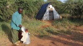A man pours camel milk in Kenya. (Sharon Deem, Saint Louis Zoo)