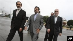 Iranian President Mahmoud Ahmadinejad, center, makes his way during a departure ceremony for him as he leaves the country for Turkey to attend an international conference in Tehran, Iran, May 9, 2011.