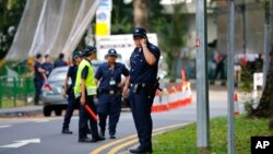 Police step up security around the venue of the international security conference in Singapore following a shootout at a roadblock in which officers fatally shot one man and detained two others, May 31, 2015.