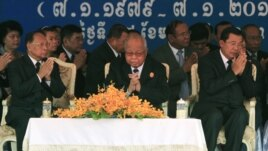 Cambodian Prime Minister Hun Sen, right, prays with President of the Cambodian National Assembly Heng Samrin, left, and Senate President Chea Sim, center, during a celebration marking the 34th anniversary of the 1979 downfall of the Khmer Rouge regime, in Phnom Penh, Cambodia, Monday, Jan. 7, 2013. (AP Photo/Heng Sinith)
