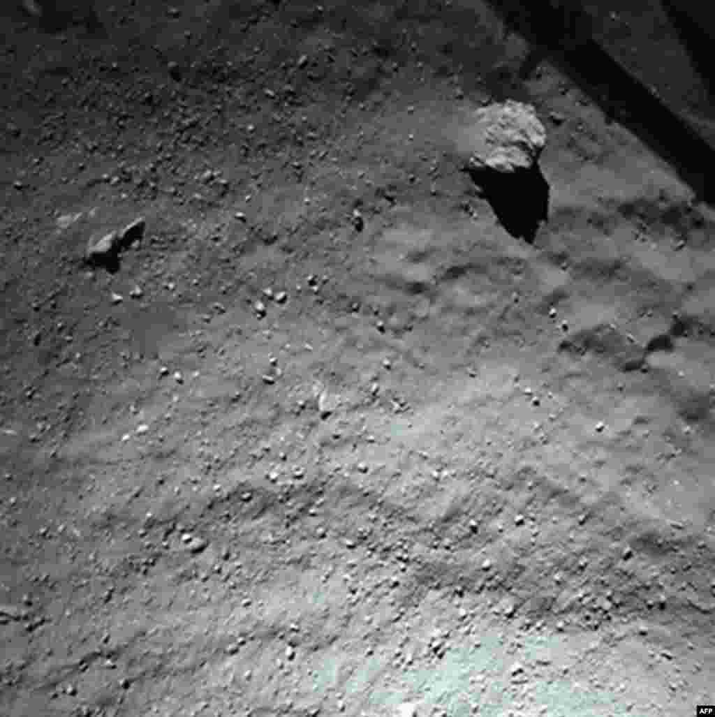 A handout photo released on November 13, 2014 by the European Space Agency, and taken by the Rosetta Lander Imaging System instrument, shows the surface of comet 67P/Churyumov-Gerasimenko during Philae's descent, from a distance of approximately 40 meters above the surface. (Courtesy: European Space Agency)