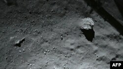 A handout photo released on November 13, 2014 by the European Space Agency, and taken by the Rosetta Lander Imaging System instrument, shows the surface of comet 67P/Churyumov-Gerasimenko during Philae's descent.