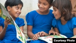 Children in Bangladesh with books supplied by Room to Read. (Room to Read)