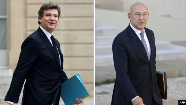 A combination of files pictures made on April 2, 2014 of French minister for Industrial Renewal Arnaud Montebourg in Paris and French Labor Employment and Social Dialogue Michel Sapin.