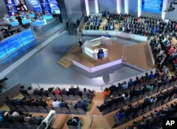 Russian President Vladimir Putin, center, speaks during his marathon call-in TV show in Moscow, April 14, 2016.
