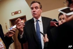 FILE - Senate Intelligence Committee Vice Chairman Sen. Mark Warner, D-Va., speaks with reporters on Capitol Hill in Washington, Sept. 27, 2017.