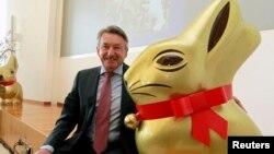 Ernst Tanner, CEO of Swiss chocolatier Lindt & Spruengli poses beside a giant 'Goldhase' rabbit in Kilchberg near Zurich, Switzerland. Mar, 15, 2011.