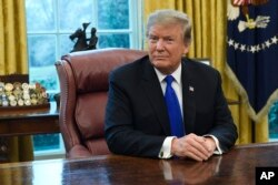 FILE - President Donald Trump listens during his meeting with Chinese Vice Premier Liu He in the Oval Office of the White House in Washington, Feb. 22, 2019.