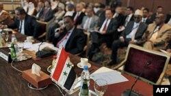 Ghế bỏ trống của đại diện Syria tại cuộc họp của liên đoàn tại Cairo, Ai Cập, ngày 12/2/2012