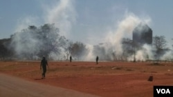 Police use teargas in an attempt to disperse protesters.