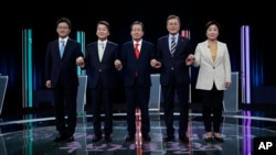 FILE - South Korean presidential election candidates (from left) Yoo Seung-min of the Bareun Party, Ahn Cheol-soo of the People's Party, Hong Joon-pyo of the Liberty Korea Party, Moon Jae-in of the Democratic Party of Korea and Sim Sang-jung of the Justice Party.