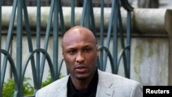 FILE - Former NBA star Lamar Odom.