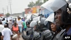 FILE - Police stand guard following demonstrations in Kinshasa, Democratic Republic of Congo, Jan. 12, 2015.