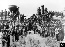 Railroad officials and employees celebrate the completion of the first railroad transcontinental link in Prementory, Utah on May 10, 1869. Despite their contribution, not a single Chinese laborers were in the photo.