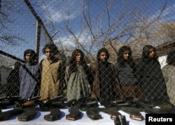 FILE - Pakistani Taliban fighters, who were arrested by Afghan border police, stand during a presentation of seized weapons and equipment to the media in Kabul, Afghanistan on January 5, 2016.