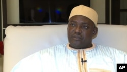 In this image taken from video, Gambia's new president Adama Barrow talks during an interview with The Associated Press in Dakar, Senegal, Jan. 21, 2017, just hours after Yahya Jammeh agreed to step down from office.