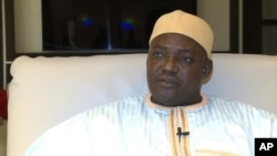 In this image taken from video, Gambia's new president Adama Barrow talks during an interview with The Associated Press in Dakar, Senegal, Jan. 21, 2017.