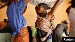 New tech targets small holders in Ghana through radio. Women load sacks of rice onto their heads in the northern Ghana town of Bolgatanga, February 1, 2008.