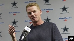 Jason Garrett responds to questions during a news conference after being named interim coach of the Dallas Cowboys, at the NFL football team's training facility in Irving, Texas, 08 Nov 2010