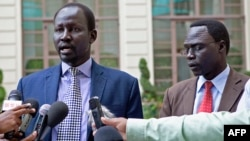 Lul Ruai Koang (left), ex-spokesman for Riek Machar's rebel group, returned to Juba after breaking with the Sudan People's Liberation Movement in Opposition (SPLM-IO).