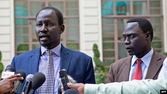 FILE - Lul Ruai Koang (L), the military spokesperson for the Sudan People's Liberation Army (SPLA) and James Gatdet Dak, spokesperson for opposition leader Riek Machar (R), give a statement to the press in Addis Ababa on May 9, 2014.