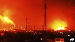 Balls of fire rise over Amuay refinery near Punto Fijo, Venezuela, August 25, 2012.