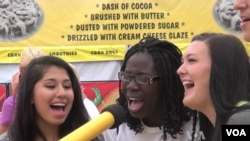 Some young people taking part in the Minnesota State Fair sing along