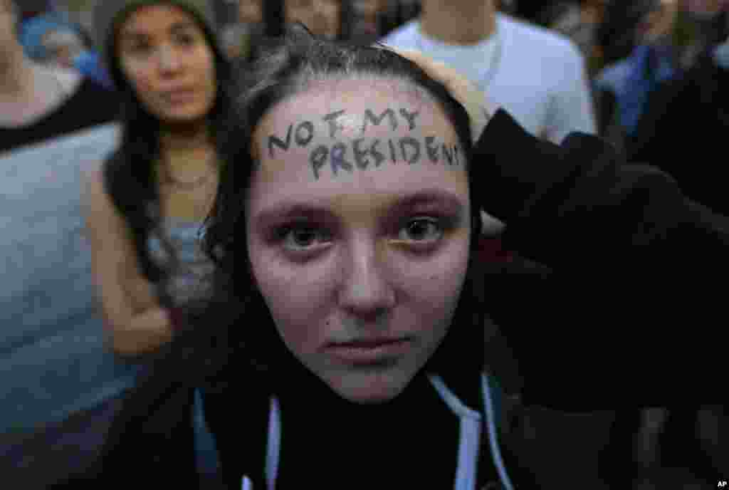 "Clair Sheehan has the words ""Not My President"" written on her forehead as she takes part in a protest against the election of President-elect Donald Trump, Nov. 9, 2016, in downtown Seattle."
