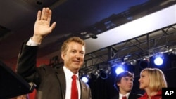 Rand Paul, a favorite of the Tea Party movement, waves to supporters after winning election as a Republican to the Senate from Kentucky