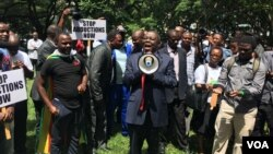 "Former Zimbabwean Prime Minister Morgan Tsvangirai addresses activists in Harare protesting the disappearance a year ago of Itai Dzamara, March 9, 2016. He said the case represented ""the unacceptable face"" of Robert Mugabe's government. (S. Mhofu/VOA)"