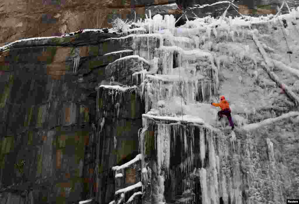 A man climbs an artificial wall of ice in the city of Liberec, Czech Republic, Feb. 8, 2015.