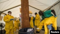 Medical staff working with Medecins sans Frontieres (MSF) put on their protective gear before entering an isolation area at the MSF Ebola treatment centre in Kailahun July 20, 2014. Sierra Leone now has the highest number of Ebola cases, at 454, surpassin
