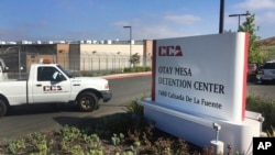 FILE - In this June 9, 2017, file photo, a vehicle drives into the Otay Mesa detention center in San Diego, Calif. The American Civil Liberties Union filed a class-action lawsuit March 9, 2018, accusing the U.S. government of broadly separating immigrant families seeking asylum.
