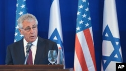 U.S. Defense Secretary Chuck Hagel speaks during a joint press conference with Israeli Defense Minister Moshe Yaalon following a meeting in Tel Aviv, May 15, 2014.