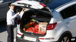 FILE - A South Korean vendor, his car filled with Choco Pie snacks and instant noodles, prepares to leave for the Kaesong Industrial Complex just north of the demilitarized zone separating the two Koreas, Sept. 16, 2013.