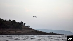 A helicopter on a search operation flies above the beach after more than a dozen college students were swept away at Murud on the Arabian Sea coast about 150 kilometers (95 miles) south of Mumbai, Maharashtra state, India, Monday, Feb. 1, 2016. Drowning is among the top five causes of death for children under 15 years in 48 of 85 countries surveyed.