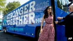 FILE - Huma Abedin, center, an aide to Democratic presidential candidate Hillary Clinton, gets off a campaign bus for Democratic presidential candidate Hillary Clinton and Democratic Vice Presidential candidate, Sen. Tim Kaine, D-Va., July 29, 2016.