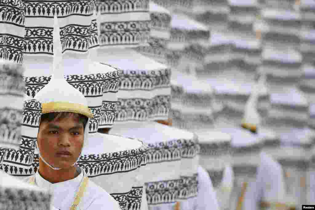 A man in traditional costume takes part in a funeral procession for Cambodia's late former King Norodom Sihanouk at the Royal Palace in Phnom Penh.