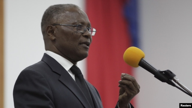 Provisional president candidate Jocelerme Privert gives his speech in the Special Bicameral Commission for the election of the provisional President of the Republic in the Haitian Parliament in Port-au-Prince, Haiti, Feb. 13, 2016.