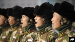 Paramilitary recruits take part in a regular training at an army base in Yinchuan, Ningxia Hui Autonomous Region, 12 Jan 2011