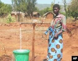 Woman at water tap