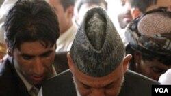 Presiden Afghanistan Hamid Karzai kehilangan penasihat seniornya, kurang dari seminggu setelah adiknya juga tewas dibunuh.