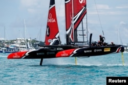FILE - Peter Burling, Emirates Team New Zealand Helmsman takes his team and boat to the finish line to defeat Oracle Team USA in race nine to win the America's Cup.
