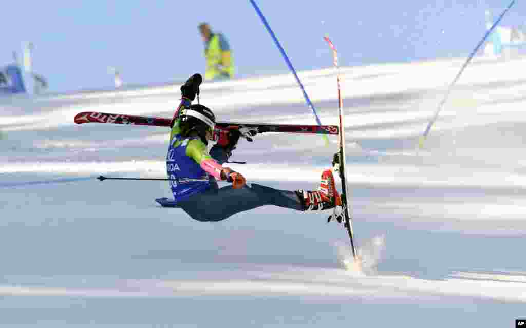 Maryna Gasienica Daniel of Poland falls as she competes during an Alpine skiing, women's World Cup Giant Slalom event, in Lienz, Austria.
