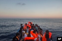 Refugees and migrants overcrowd a wooden boat during a rescue operation on the Mediterranean sea, about 19 miles north of Az Zawiyah, Libya on July 21, 2016.