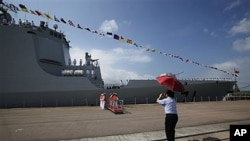Visitor photographs missile destroyer Haikou 171, Hong Kong, April 30, 2012.
