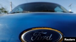 The Ford logo is seen on the front of a car in Cuautitlan Izcalli, Mexico, Jan. 4, 2017.